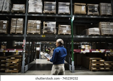 A Caucasian man checking stock inventory
