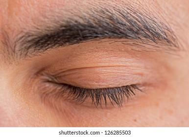 Caucasian man closed left eye and eyebrow