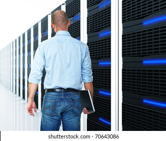 caucasian man and  datacentre with lots of server