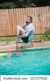 Caucasian Man Does Cannon Ball Jumps Into Blue Backyard Pool