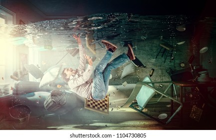 caucasian man is drowning in his living room abstract image