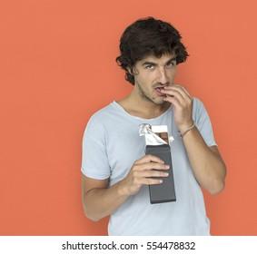 Caucasian Man Eating Chocolate Concept