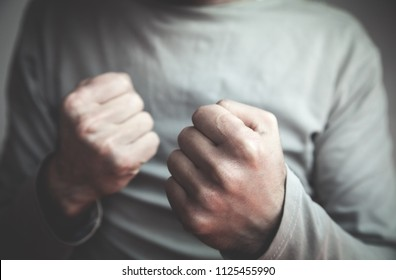 Caucasian man with fight gesture. Aggression concept