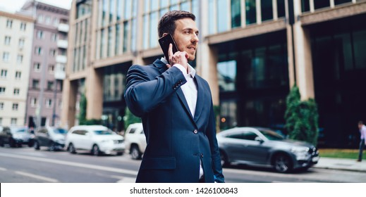 Caucasian man in formal wear making smartphone international conversation discussing business project, intelligent male corporate director using roaming 4g for phoning via modern mobile gadget
