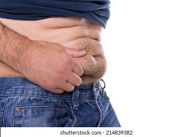 A caucasian man grabs his far hairy belly