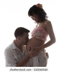 Caucasian man holding asian pregnant woman,silhouette