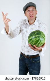 Caucasian man offers a watermelon