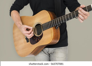 Caucasian Man Playing Guitar Closeup