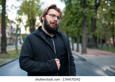 Caucasian man posing on the street middle adult person portrait of bearded person in autumn park outdoor background unfocused environment space