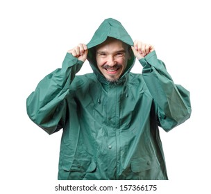 Caucasian man in a rain suit putting the hood over the head isolated on white background.
