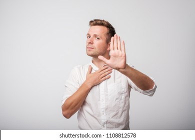 A caucasian man shows the hands stop.