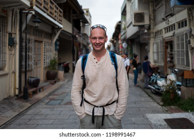 Caucasian man smiling on the streets of Tainan, Tainan.