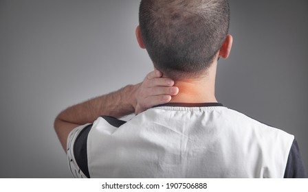 Caucasian man suffering from neck pain.