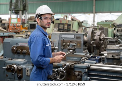 Caucasian man in uniform works hold laptop on the production. Industrial modern technology.