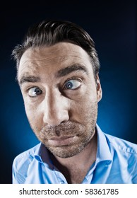 caucasian man unshaven squinting eye problem portrait isolated studio on black background