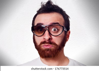 Caucasian man in white t shirt with fancy broken glasses