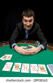 Caucasian man win with four of a kind in casino poker