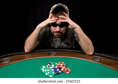 Caucasian man wins a lot of casino chips over black