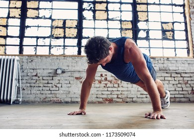 Caucasian Man Works Out By Doing Push Ups