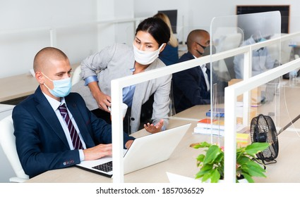 caucasian managers in white office during pandemic - Shutterstock ID 1857036529