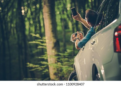 Caucasian Men in His 30s Looking For Cellphone Signal From Inside His Car.