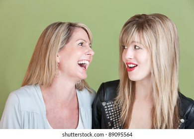 Caucasian mom with retro-styled daughter laugh together