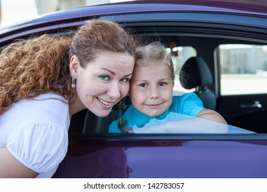 Caucasian mother and little girl together with own land vehicle