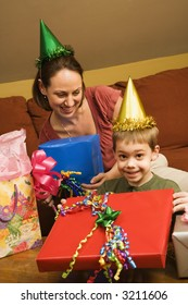 Caucasian mother and son celebrating a birthday party.