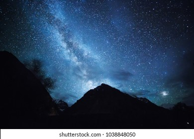 Caucasian mountains in Bezengi night lanscape with stars and mikly way