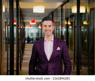 Caucasian New York City Man Works In His Office While Wearing A Purple Suit