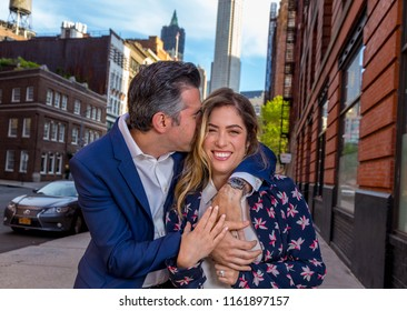 Caucasian New York City Man and Woman Couple Act Silly and Lovingly On The Streets Of Manhattan