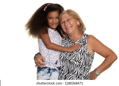 Caucasian older woman hugging her african american granddaughter - Isolated on white
