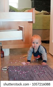 Caucasian One Year Old Infant Toddler Boy Crawling In Bathroom With Open Drawers Making Mess with Cotton Swab In Mouth Mischief Naughty