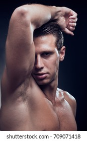 Caucasian one young adult man, muscular fitness model, head face headshot, head and shoulders shot, close up, side view, black background studio