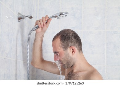 Caucasian person in bathroom. Man taking shower