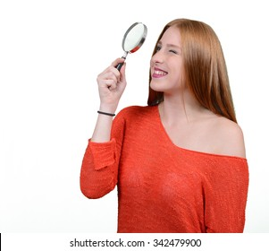 Caucasian redhead girl magnifying isolated