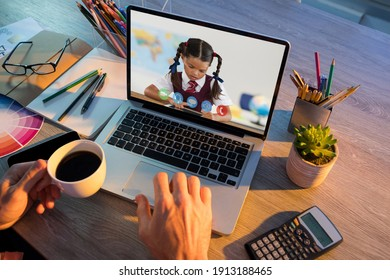 Caucasian schoolgirl learning displayed on laptop screen during video call with male teacher. Online education staying at home in self isolation during quarantine lockdown.