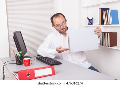 Caucasian senior businessman in office with blank big card