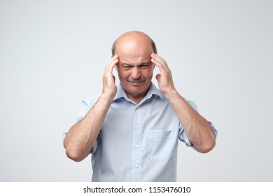 Caucasian senior man having terrible headache. Problem with health at old age
