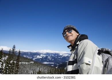 Caucasian senior man skier posing on mountain Whistler, British Columbia, Canada.