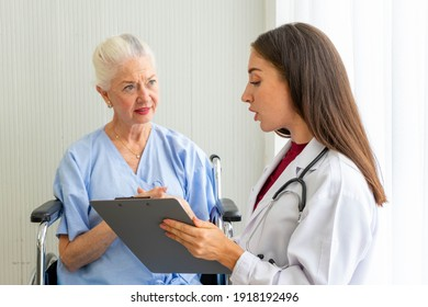 Caucasian senior woman patient on wheelchair with medical doctor woman wearing stethoscope diagnosis