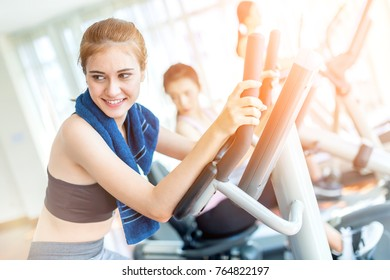 CAUCASIAN sport woman enjoy workout with treadmill in gym fitness center with group of people