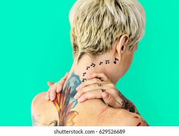 Caucasian tattooed woman bare back
