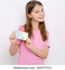 Caucasian teen girl holding euro