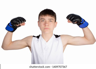 Caucasian teenage boxer flexing his muscles
