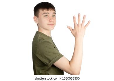 Caucasian teenage boy doing British Sign Language showing the symbol for 5