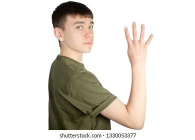 Caucasian teenage boy doing British Sign Language showing the symbol for 4