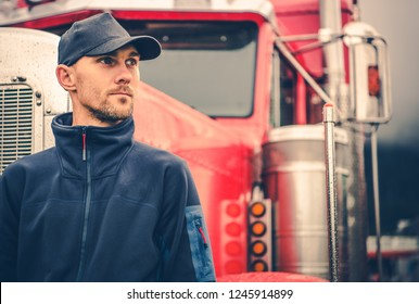 Caucasian Trucker in His 30s Portrait. Truck Driving and Logistics Industry.