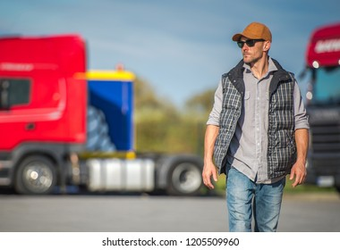 Caucasian Trucker in His 30s and the Truck Stop. Transportation Industry.