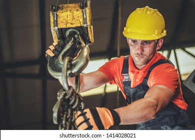 Caucasian Warehouse Lift Operator in His 30s. Heavy Duty Lifting Equipment.